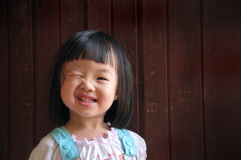 Clin d'oeil de jeune fille Photos stock