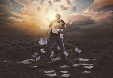 Clinging on to falling papers Stock Photography