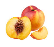 Clingstone. Whole and nectarine segment Royalty Free Stock Photos
