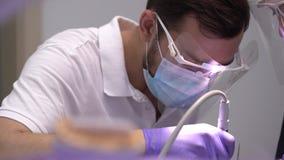 Clinic dentistry, installation of veneers to patient in dental clinic. Dentist doctor beautiful teeth, smile. Close up. Clinic dentistry, installation of veneers stock video footage