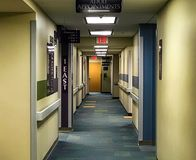 Clinic hallway with directional signs and lights stock image