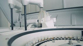 Clinical chemistry analyzer is testing samples. 4K stock footage