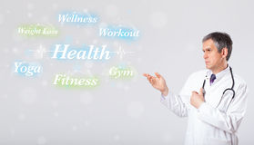 Clinical doctor pointing to health and fitness collection of wor Royalty Free Stock Image