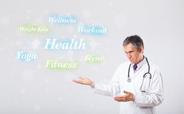 Clinical doctor pointing to health and fitness collection of wor Royalty Free Stock Photos
