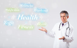 Clinical doctor pointing to health and fitness collection of wor Stock Photography