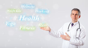 Clinical doctor pointing to health and fitness collection of wor Royalty Free Stock Photo