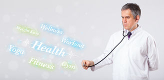 Clinical doctor pointing to health and fitness Royalty Free Stock Photography
