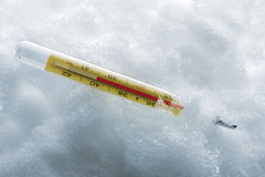 Clinical Thermometer in snow Stock Photos