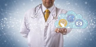 Clinician Activates AI Aided Medical Diagnostics royalty free stock image