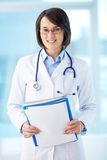 Clinician with documents Stock Photo