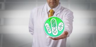 Clinician Offering Drugs Based On DNA Profiling. Unrecognizable clinician offering drugs based on DNA profiling. Healthcare and pharma industry concept for stock photography