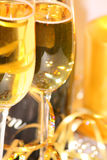 Clink clink. Two champagne glasses small dof Stock Photos