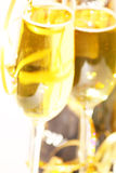 Clink clink. Two champagne glasses small dof Royalty Free Stock Photos
