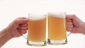 Clink glasses with beer Stock Photography