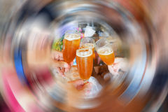 Clink glasses. Blur of people Clink glasses Juice Or drink Royalty Free Stock Photos
