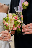 Clink glasses. By bride and groom Stock Photos