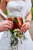 Clink glasses. By bride and groom Stock Images