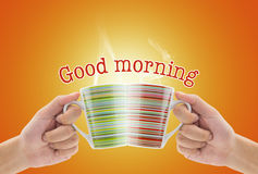 Clink glasses a cup of coffee. And text word good morning Royalty Free Stock Images