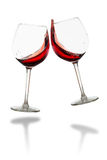 Clink glasses - red wine isolated Stock Photography
