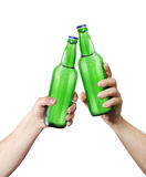 Clink glasses. Two hands holding a bottles. Template for the ability to use any brand label on a white background Stock Images