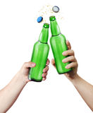 Clink glasses. Two hands holding a bottles. Stock Photos