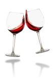Clink szkła - czerwone wino odizolowywający Fotografia Stock