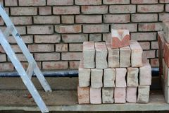 Clinker work. Scaffold with ladder and wall bricks Royalty Free Stock Image