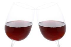 Clinkgläser mit Rotwein Stockbild