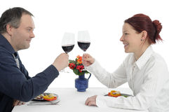 Clinking. Couple at dinner table Royalty Free Stock Photos