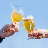 Clinking Beer glasses against the sky. Stock Photos