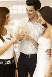 Clinking with champagne Stock Images