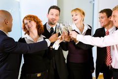 Clinking champagne glasses Stock Photos