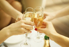 Clinking glasses of champagne royalty free stock images