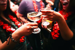Clinking glasses and toasting. Clinking glasses with alcohol and toasting, party. Congratulations to the event. Cheerful party friends stock image