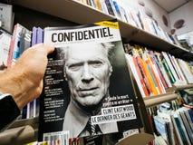 Clint Eastwood στην κάλυψη του περιοδικού Confidentiel γραπτή Στοκ Εικόνα