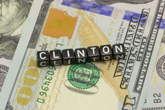 Clinton, on the background. Of US dollars stock image