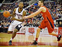 Men's CIS Basketball Finals. Clinton Springer-Williams (left) in action for the Carleton Ravens in their match against Acadia Axemen at Scotiabank Place, Ottawa stock photo