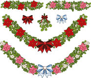 Clip art set of Christmas mistletoe decorative. Clip art set of white Christmas mistletoe decorative garland elements  with red and pink poinsettia Stock Photos
