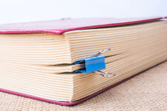Clip attached to some pages of a book. Clip attached to some pages of the book royalty free stock photo