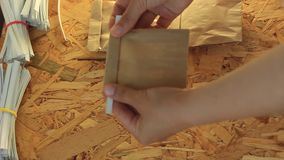 Clip band for paper bags packaging, how to close kraft paper bag, a step-by-step video instruction. Clip band for paper bags packaging, how to close kraft paper stock footage