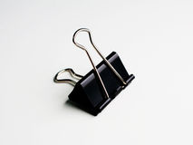 Clip1. Black hard clip with 2 steal legs on white shade background Stock Images