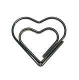Clip. Black clip in the shape of heart isolated on white Royalty Free Stock Photos