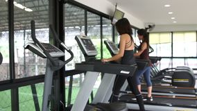 Blur Asian women walking on treadmill gym workout. Clip of Blur Asian women walking on treadmill gym workout stock video
