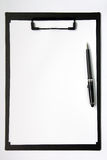 Clip board. Black color clip board with blank paper and ball pen stock image