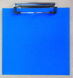 Clip board and colored paper Royalty Free Stock Photography