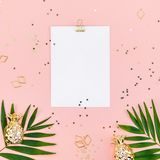 Clip board mock up with green tropical leaves. Creative flat lay top view mock up blank paper sheet postcard clip board green tropical palm leaves on millennial royalty free stock images
