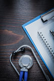 Clip board notepad pen and medical stethoscope Stock Photos