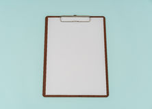 Clip board and paper on blue background . Royalty Free Stock Images