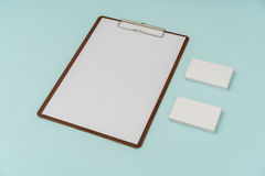 Clip board, paper and business card on blue background . Stock Photography