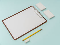 Clip board, paper,pencil  and business card on blue background . Stock Images